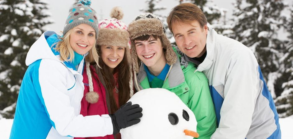 Family building a snow man