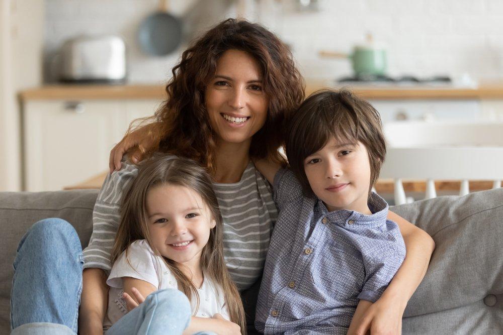 mother holding children